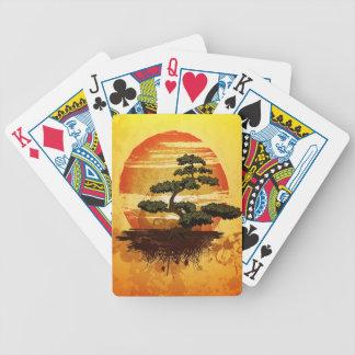 Puesta del sol japonesa del árbol de los bonsais barajas de cartas