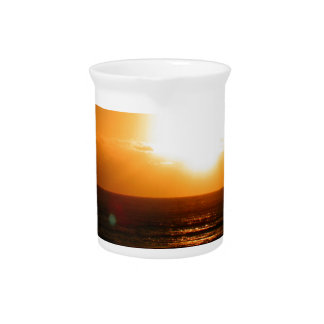 Puesta del sol jarra de beber