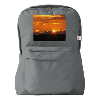 Puesta del sol magnífica mochila