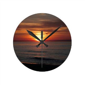 Puesta del sol maravillosa relojes de pared