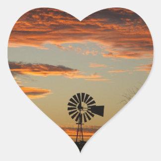 Puesta del sol occidental del molino de viento pegatinas corazon personalizadas