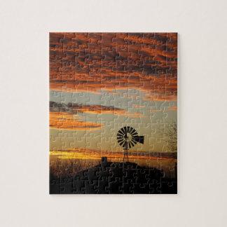 Puesta del sol occidental del molino de viento puzzles