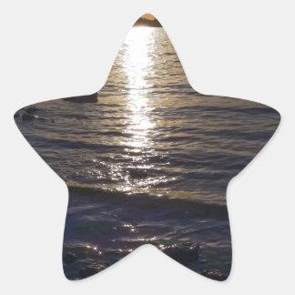 Puesta del sol pegatina en forma de estrella