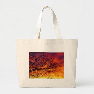 Puesta del sol pintada bolsas