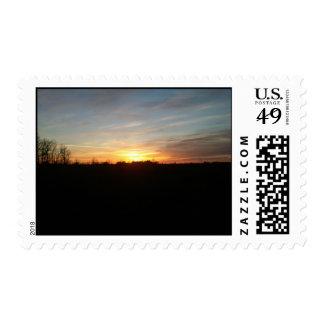 Puesta del sol por el franqueo de Grand Forks Dako