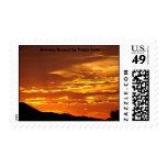 Puesta del sol, puesta del sol de Arizona por el Estampilla