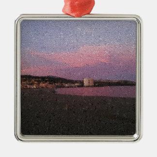 Puesta del sol púrpura del océano en el mosaico de adorno cuadrado plateado