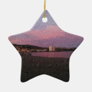 Puesta del sol púrpura del océano en el mosaico de adorno de cerámica en forma de estrella