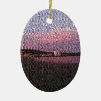 Puesta del sol púrpura del océano en el mosaico de adorno ovalado de cerámica