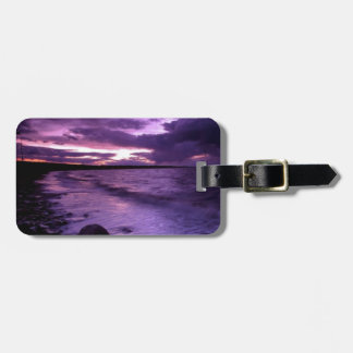 Puesta del sol púrpura del océano etiqueta para maleta