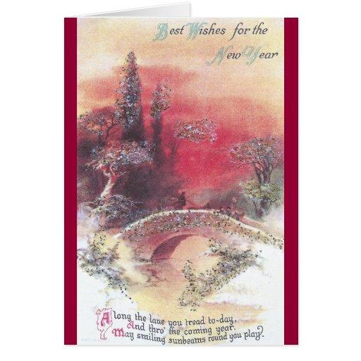 Puesta del sol roja sobre la tarjeta del Año Nuevo