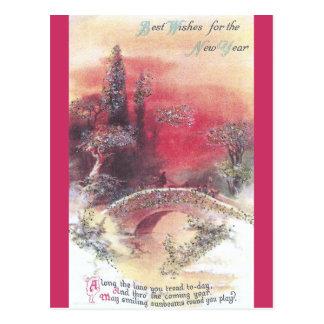 Puesta del sol roja sobre la tarjeta del Año Nuevo Postal