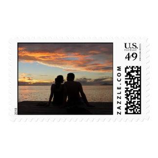 Puesta del sol romántica en Tahití Sello