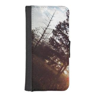 puesta del sol sobre el campo billetera para iPhone 5