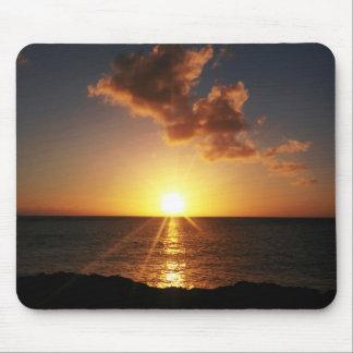 Puesta del sol sobre el cojín de ratón del océano alfombrilla de ratón