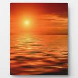 Puesta del sol sobre el océano placa de plastico