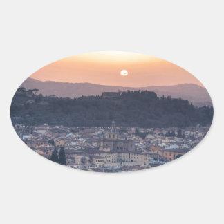 Puesta del sol sobre Florencia, Italia Pegatina Ovalada
