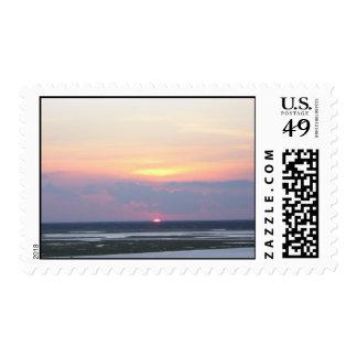 Puesta del sol sobre la bahía en Margate, NJ Sello