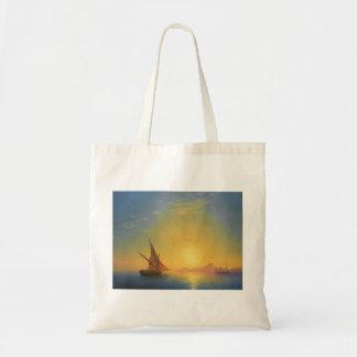 Puesta del sol sobre las aguas del paisaje marino  bolsa