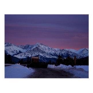 Puesta del sol sobre los Rockies Postal
