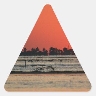 Puesta del sol sobre Sanibel Pegatina Triangular