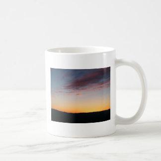 puesta del sol taza
