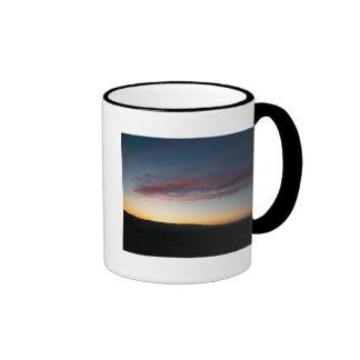 puesta del sol tazas de café