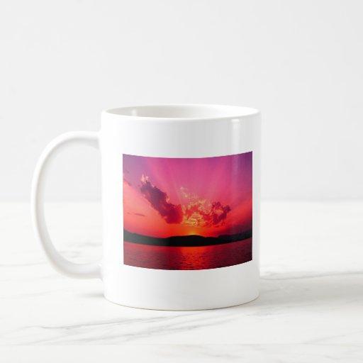Puesta del sol,     taza del café de Terry