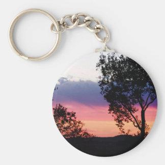 Puesta del sol temprana llavero redondo tipo pin