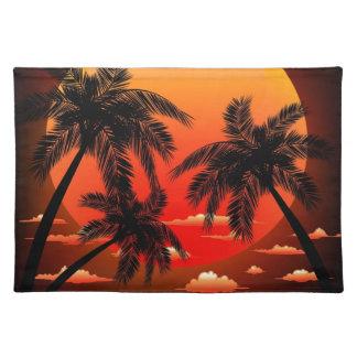 Puesta del sol tópica caliente y palmeras manteles individuales