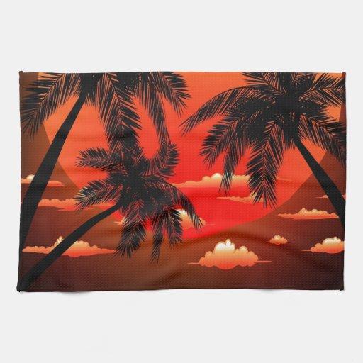 Puesta del sol tópica caliente y palmeras toalla de cocina