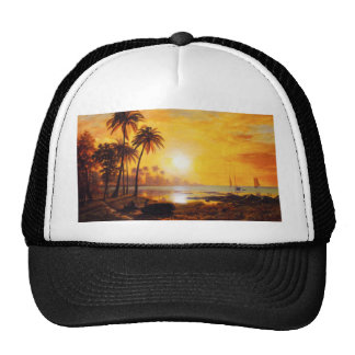 Puesta del sol tropical con el gorra de los barcos
