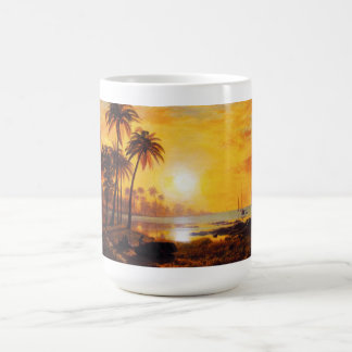 Puesta del sol tropical con la taza de los barcos