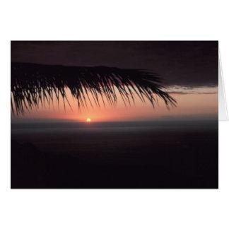 Puesta del sol tropical de la playa felicitacion