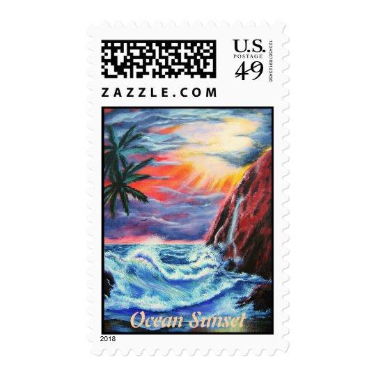Puesta del sol tropical por el océano sellos postales