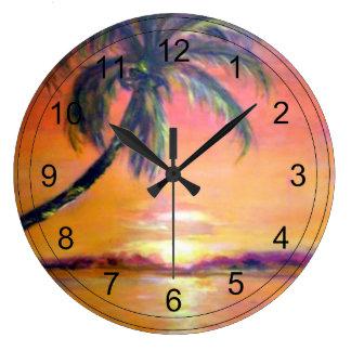 Puesta del sol tropical relojes de pared