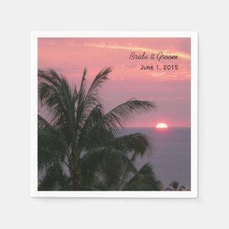 Puesta del sol tropical rosada que casa las servilletas de papel