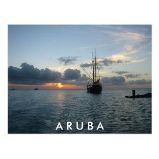 Puesta del sol y barco en Aruba Postal