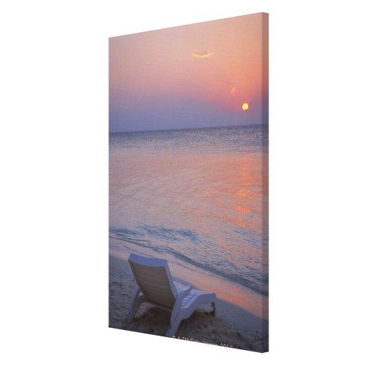 Puesta del sol y mar lona envuelta para galerias