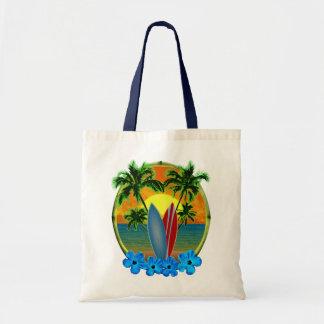 Puesta del sol y tablas hawaianas bolsas