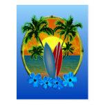 Puesta del sol y tablas hawaianas postales