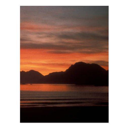Puestas del sol de la playa postal