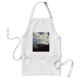 Puffy clouds in blue sky over mountain adult apron