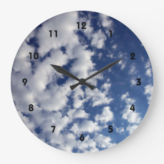 Puffy Clouds On Blue Sky Clocks