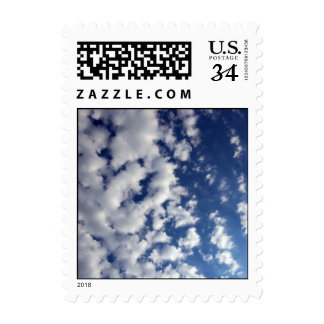 Puffy Clouds On Blue Sky – Small Postage