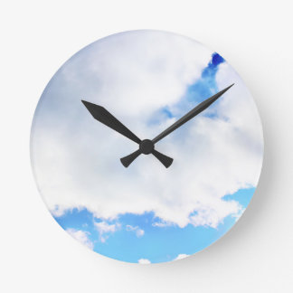 Puffy White Clouds and Blue Sky Round Clock