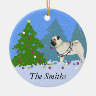 Pug decorating a Christmas Tree in the forest Ceramic Ornament