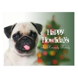 Pug dog against Christmas tree with bokeh Postcard