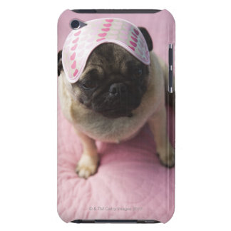 Pug dog with eye mask on head sitting on bed, iPod touch case