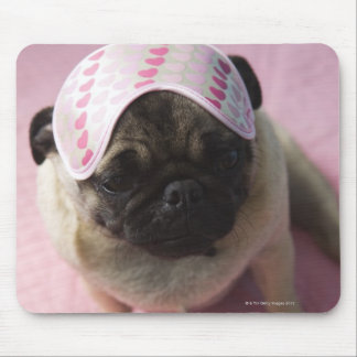 Pug dog with eye mask on head sitting on bed, mouse pad
